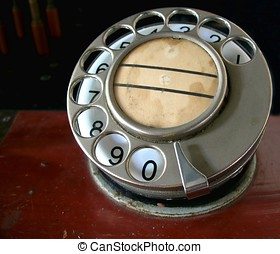 Vintage Phone Dial - An old rotary telephone dial that is...