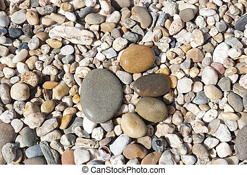 Stone foot on the stony beach - Foot print from stones on...
