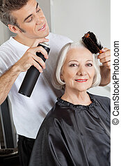 Woman Getting Her Hair Styled - Portrait of senior woman...