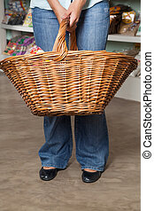 Female Customer Carrying Wicker Basket