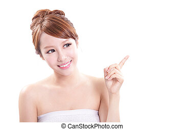 young woman showing beauty product - Beauty portrait of...