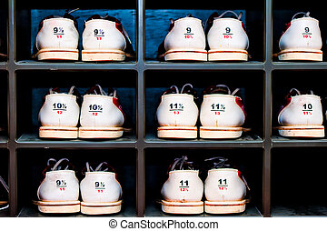 rack with shoes for bowling in different sizes