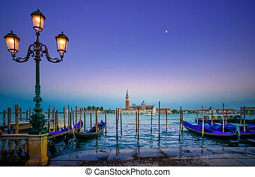 Venice, street lamp and gondolas or gondole on sunset and...