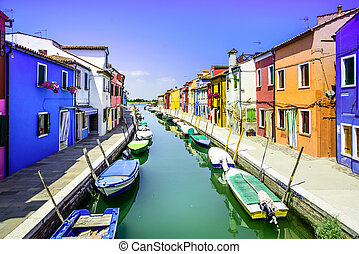 Venice landmark, Burano island canal, colorful houses and boats, Italy. Long exposure photography