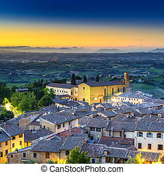 San Gimignano night aerial view, church and medieval town...