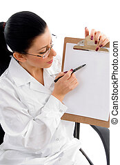 side view of female doctor indicating writing pad with white background