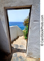 Way out - Doorway leading outdoors to the blue ocean