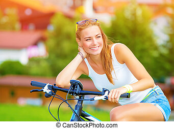 Happy woman on the bicycle - Happy woman traveling on...