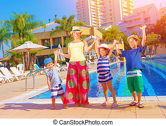 Happy family near pool - Happy family having fun near pool...