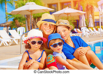 Mother with kids on beach resort - Mother with kids relaxing...