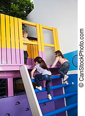 Girls Climbing Playhouse Ladder While Boy Looking At Them -...