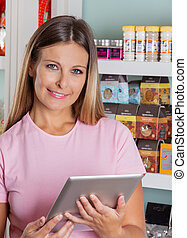 Portrait Of Woman With Digital Tablet In Grocery Store