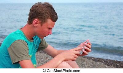 Boy on Beach with Phone