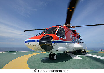 The S92 helicopter park on oil rig to pick up worker