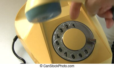 Emergency Dialing 112 - A hand lifts telephone receiver and...