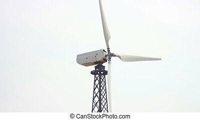 Wind Power - wind turbines spinning in the wind