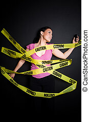 Businesswoman trapped in caution tape - A businesswoman...
