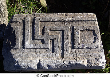 swastika - Old swastika on ruins of Kaunos near Dalyan,...