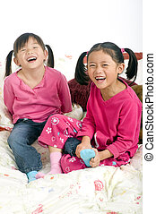 Tickling feet - Two sisters playing on the bed, tickling...