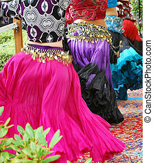 Belly dancers. - Belly dancers performing on stage outside.