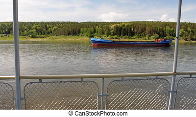 Passenger ship. - Ship floats. River banks.