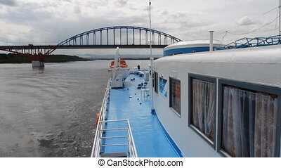 Passenger ship. - Ship floats. River banks. Bridge over...