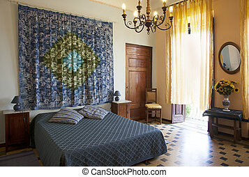 Bedroom in Tuscany style, Lucca. Italy - Interior shot of...