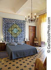 Interior shot of Bedroom - Bedroom in Tuscany style. Hotel...