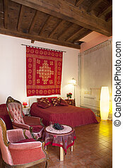 Bedroom in red colors - Interior of Bedroom in Tuscany...