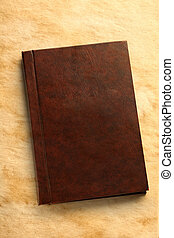 Notebook on stained paper background