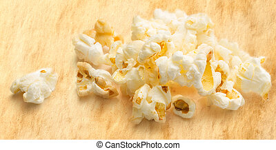 Popcorn on stained paper background