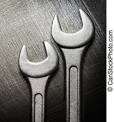 Spanner on steel scratchy background