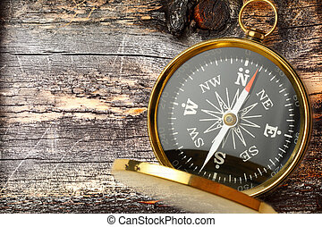 Compass on cracked wooden background