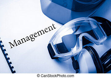 Management with goggles, earphones and helmet