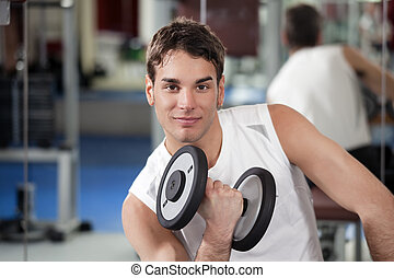 weight lifting - portrait of young man doing weightlifting...