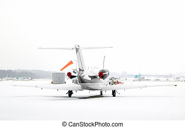 airport white-out - business jet snowed in at an airport