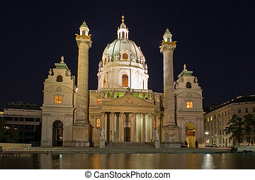 Karlskirche in Vienna, Austria at night - Cathedral of St....