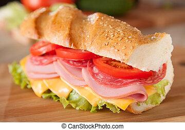 big sandwich on wooden cutting board