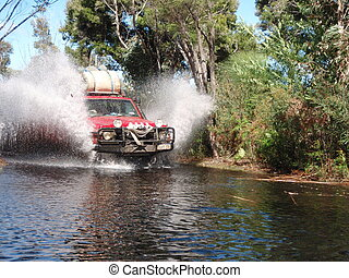 Four Wheel Driving - Four wheel driving water crossing, in...