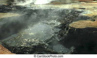 field of mud pools and fumaroles at hverir in iceland