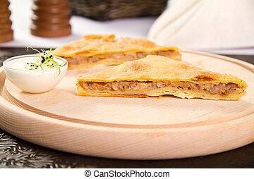 Meat pie - Minced meat pie on a wooden board