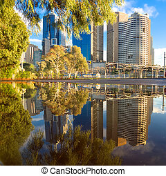 muddled puddle - melbourne city buildings reflected in a...