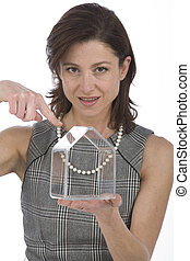 portrait of 40s woman with a transparent house on the hand