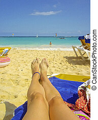 Legs in a Chair at the Beach - Point of view of a woman legs...