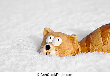 snow cat - ceramic toy cat sinking into snow