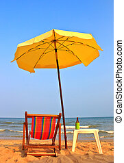 Chair on the beach 2 - Beach chair and umbrella on tropical...