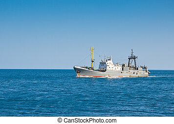 fishing trawler floating in the sea