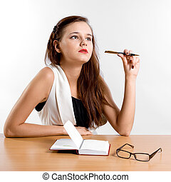 thinking businesswoman sitting at her desk - stylish...