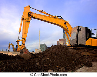 little yellow digger - heavy machinery working on a...