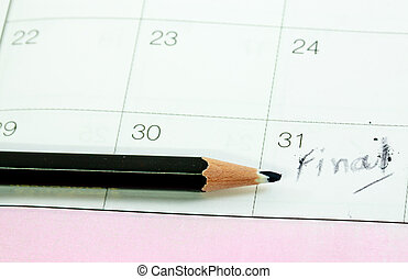 Closeup photo of pencil on calenda